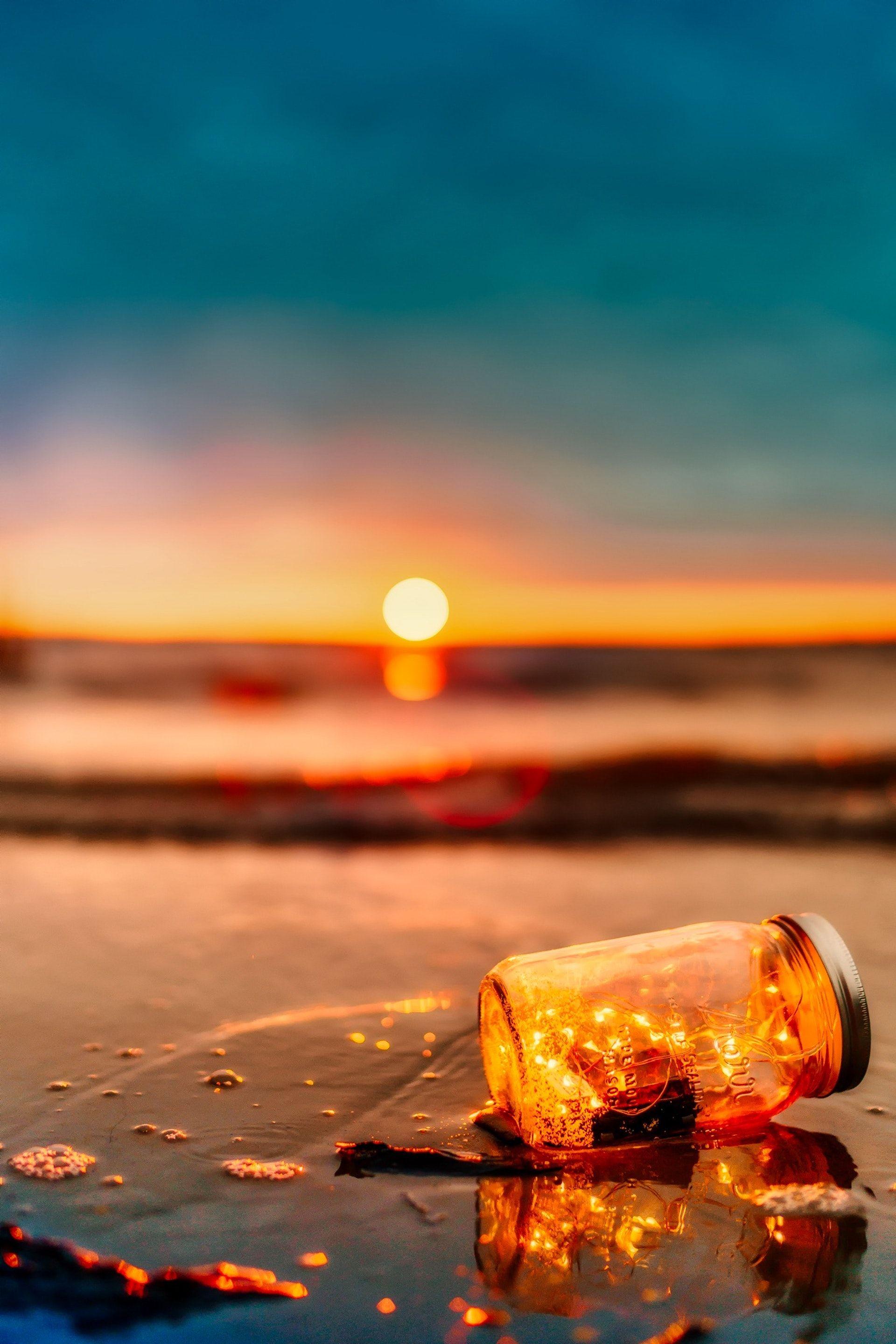 عکس زمینه زیبا غروب ساحل پس زمینه