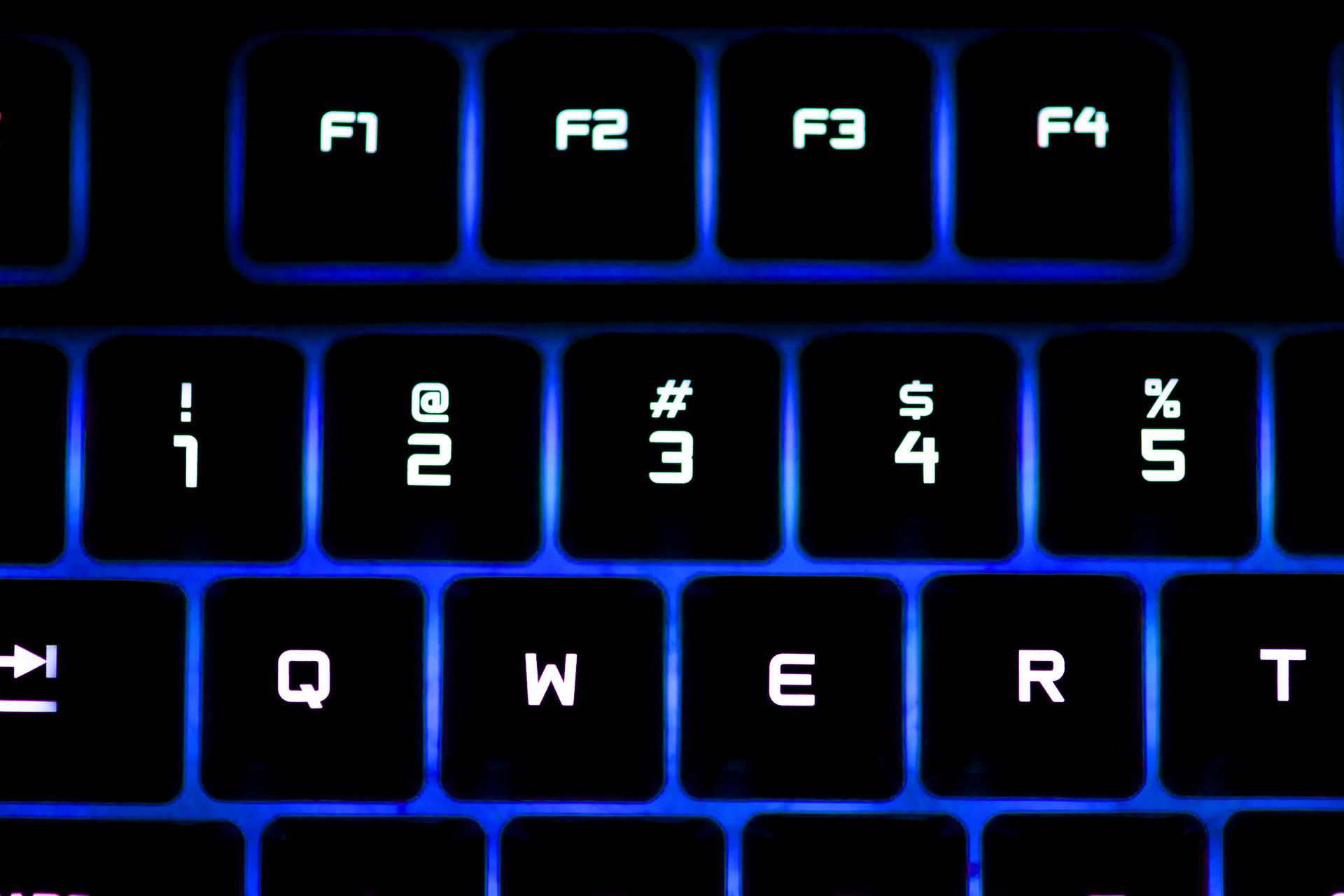 عکس زمینه صفحه کلید نئونی روشن پس زمینه