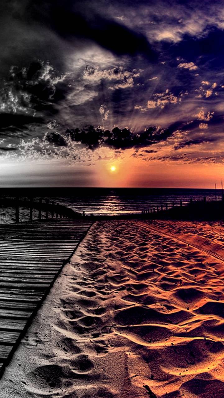 عکس زمینه غروب ساحل ابری HDR پس زمینه