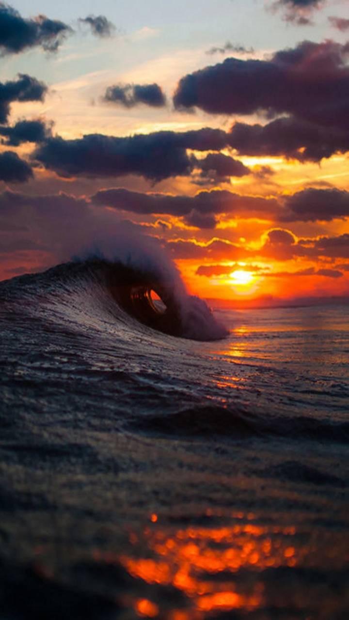 عکس زمینه غروب و امواج دریا پس زمینه