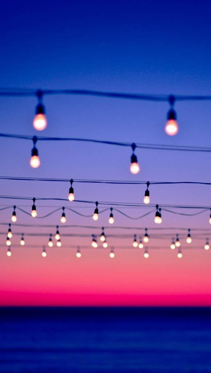 عکس زمینه هنری غروب و چراغ های روشن پس زمینه