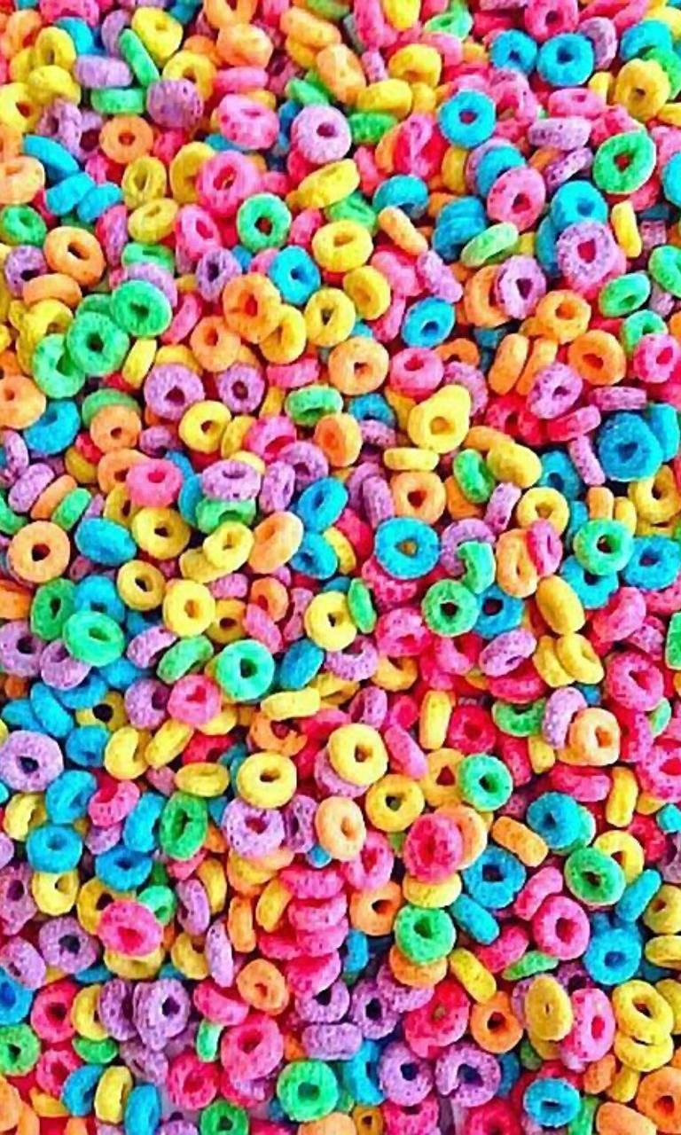 عکس زمینه حلقه های رنگی خوراکی پس زمینه