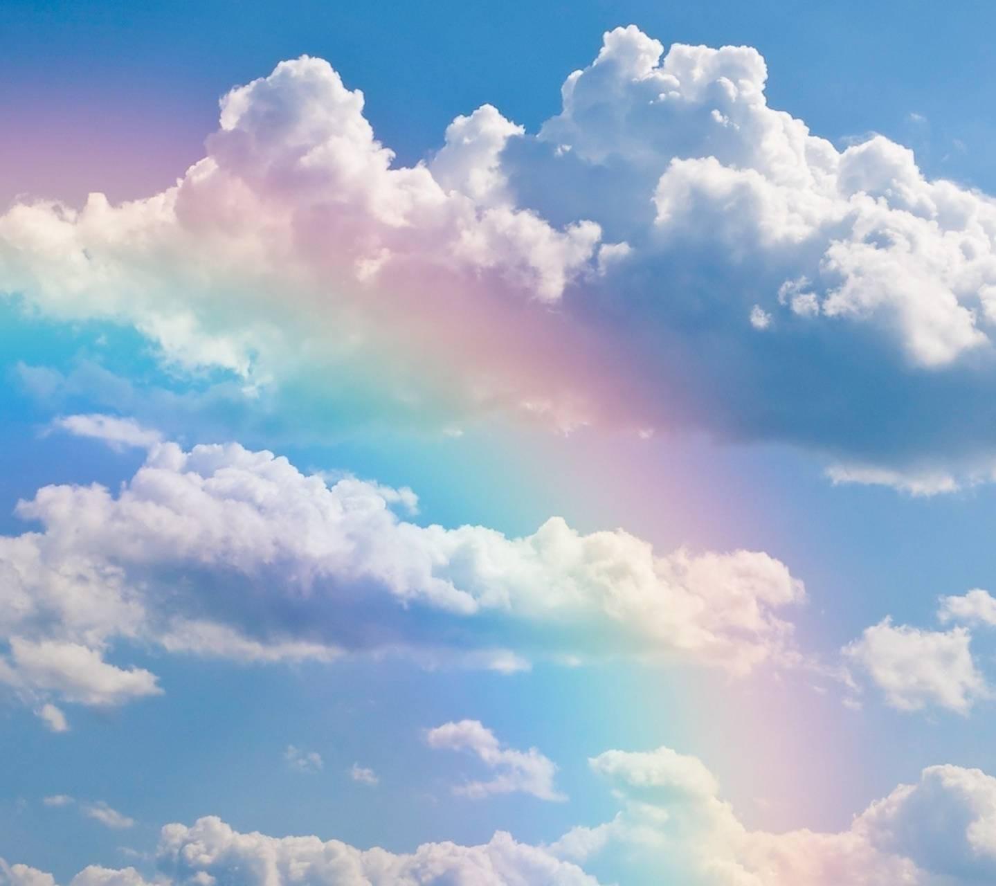 عکس زمینه ابرها و رنگین کمان پس زمینه