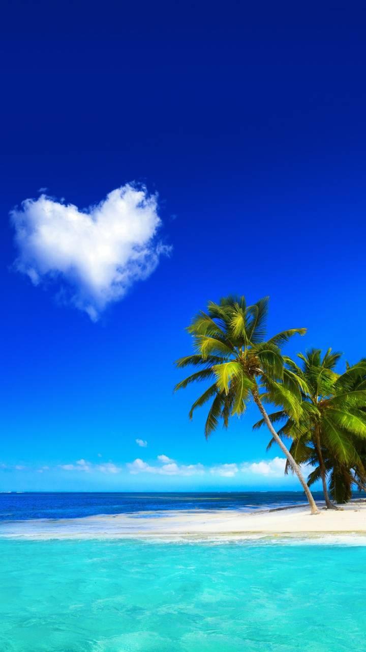 عکس زمینه قلب ابری و ساحل گرم عاشقانه پس زمینه