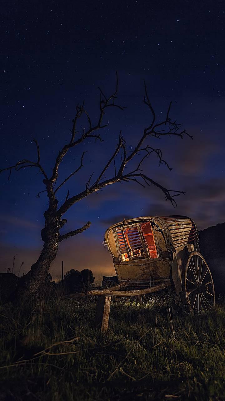 عکس زمینه کالسکه در شب پس زمینه