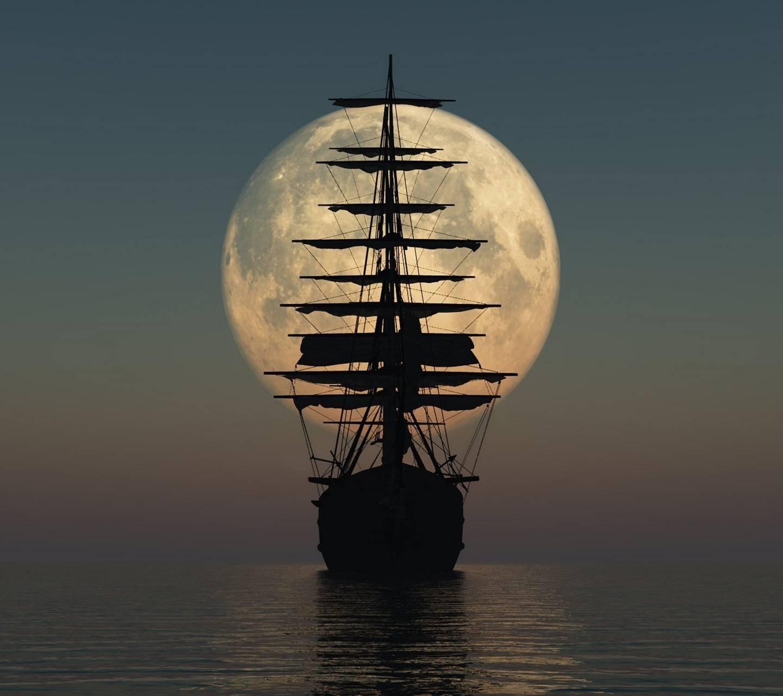 عکس زمینه کشتی و ماه پس زمینه