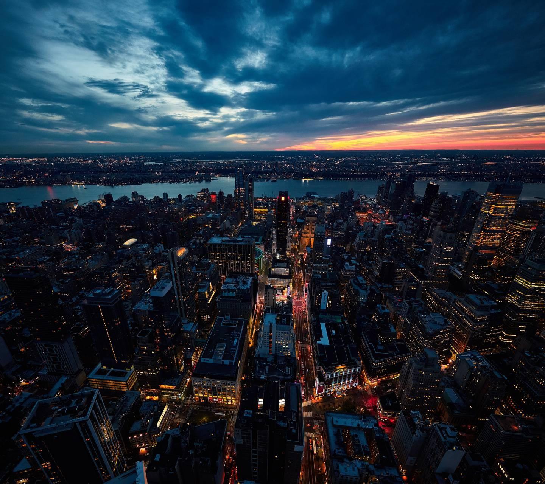 عکس زمینه نمای هوایی شهر نیویورک در شب پس زمینه