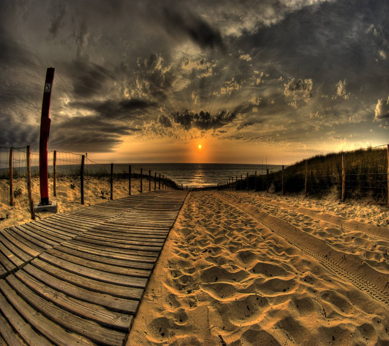 عکس زمینه غروب لب ساحل پس زمینه