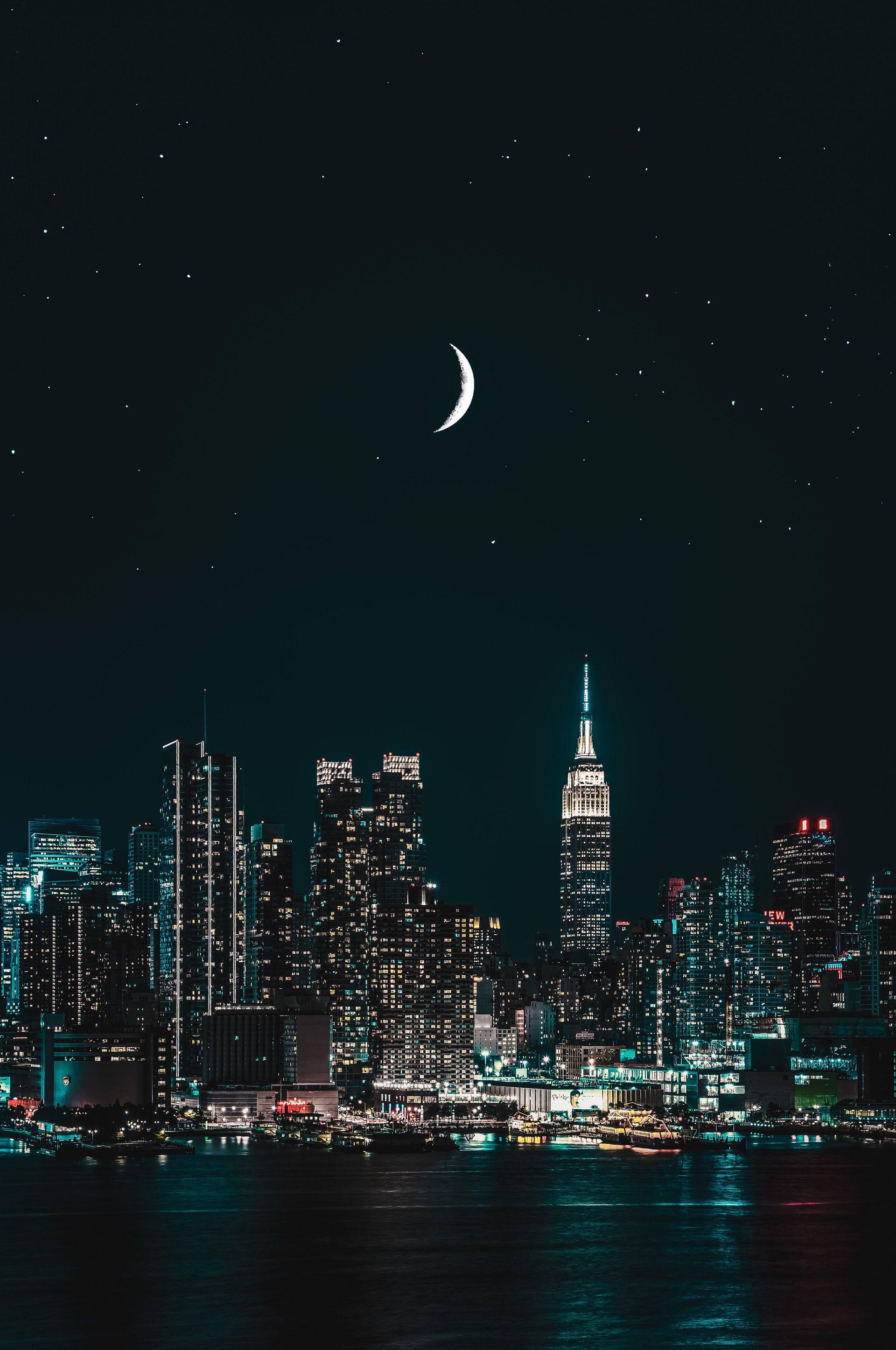 عکس زمینه ساختمان های بلند نیویورک د شب پس زمینه