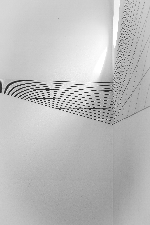 عکس زمینه اشکال هندسی سیاه و سفید روی دیوار پس زمینه