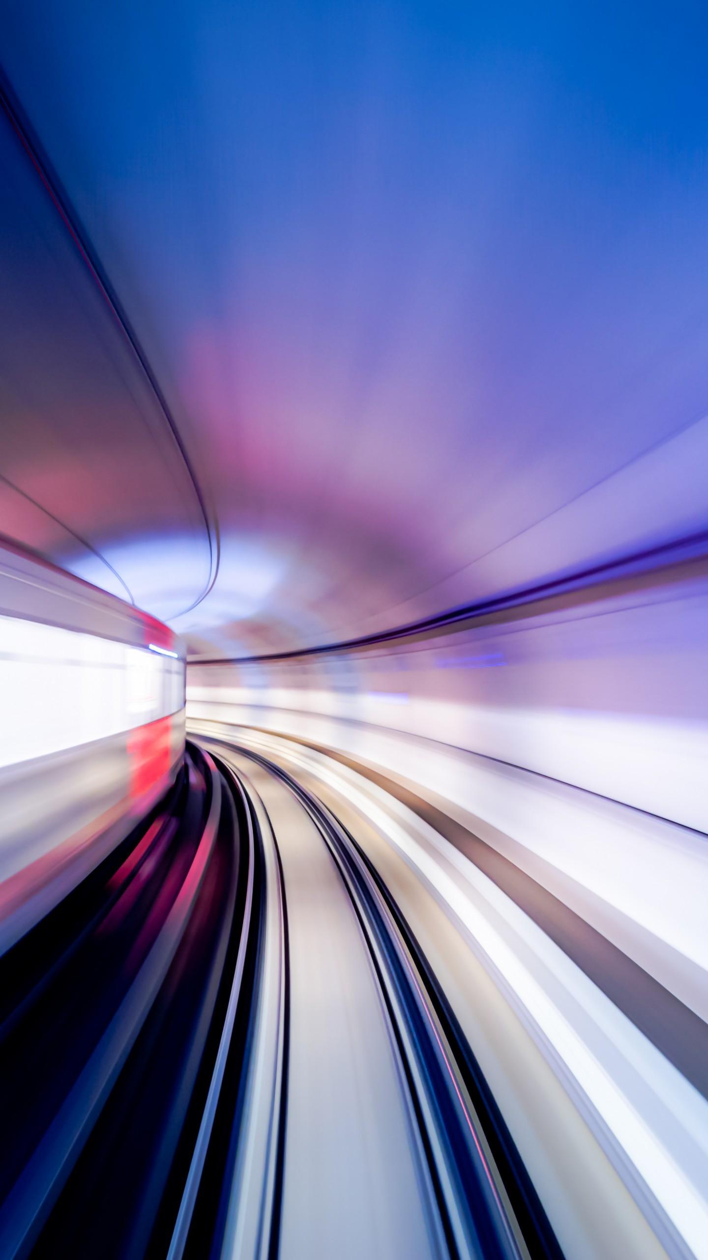 عکس زمینه عکسبرداری از تونل طولانی رنگارنگ پس زمینه