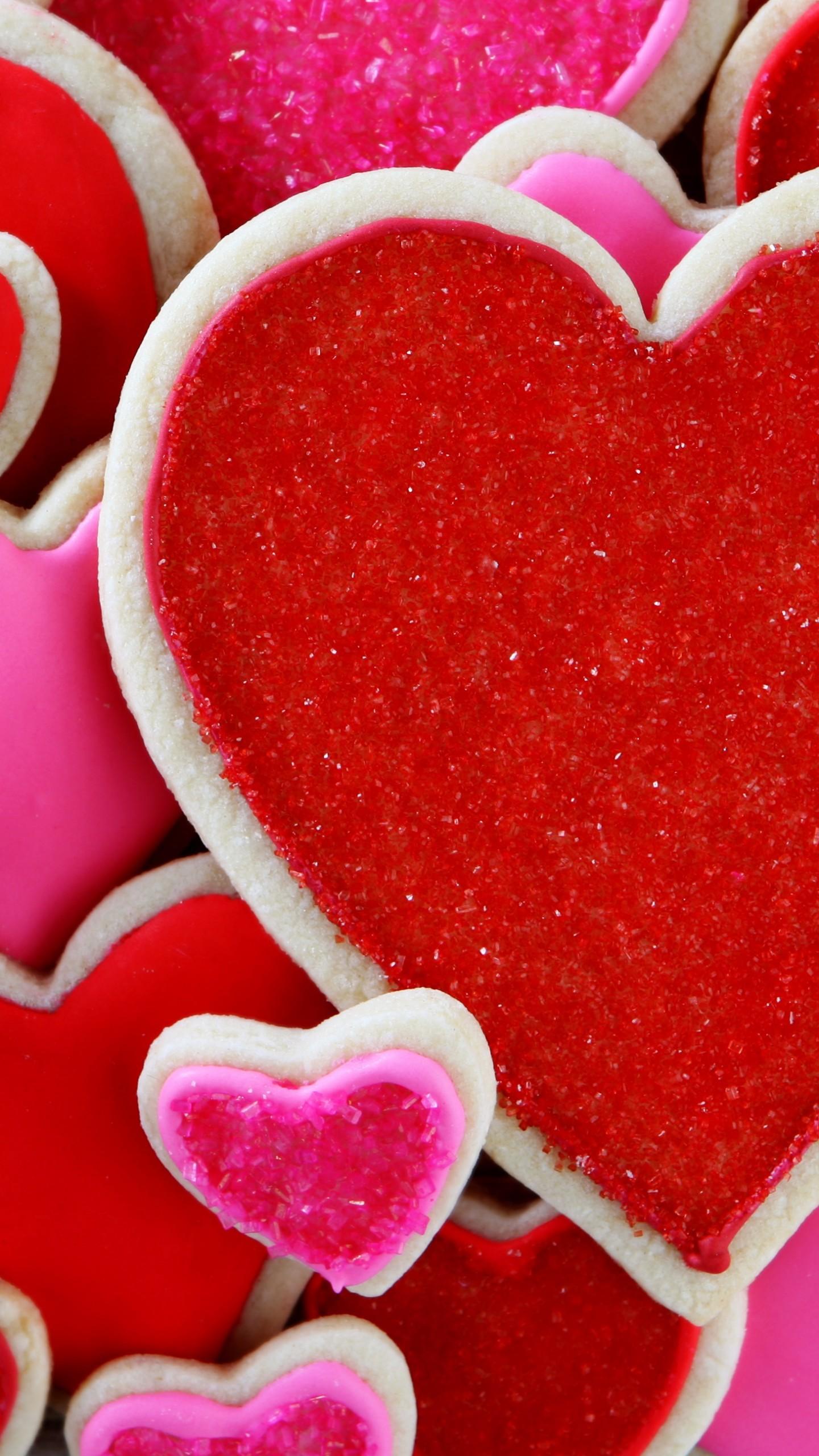 عکس زمینه قلب های بیسکویتی قرمز رنگ پس زمینه