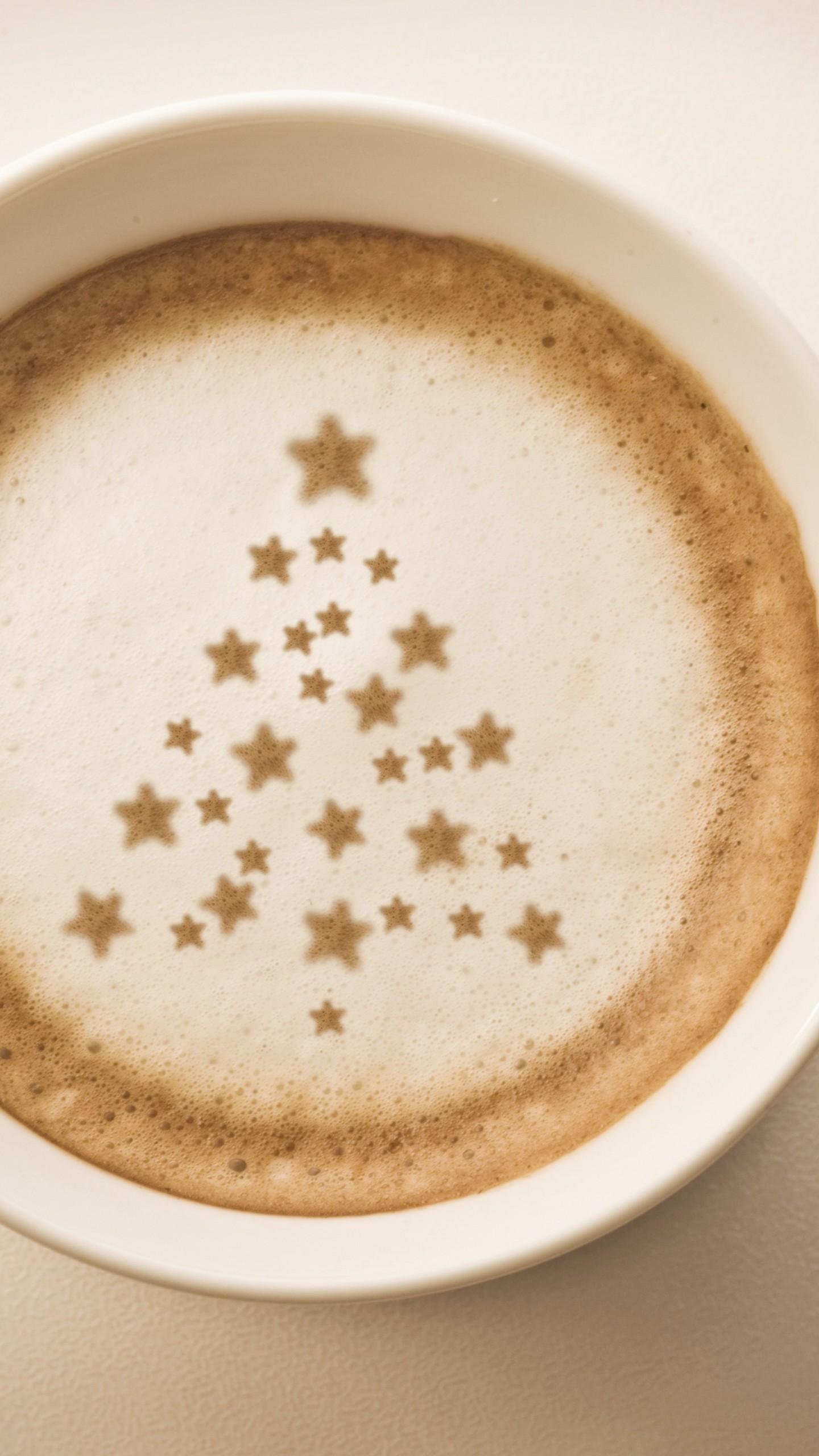 عکس زمینه ستاره ها بر روی فنجان قهوه پس زمینه