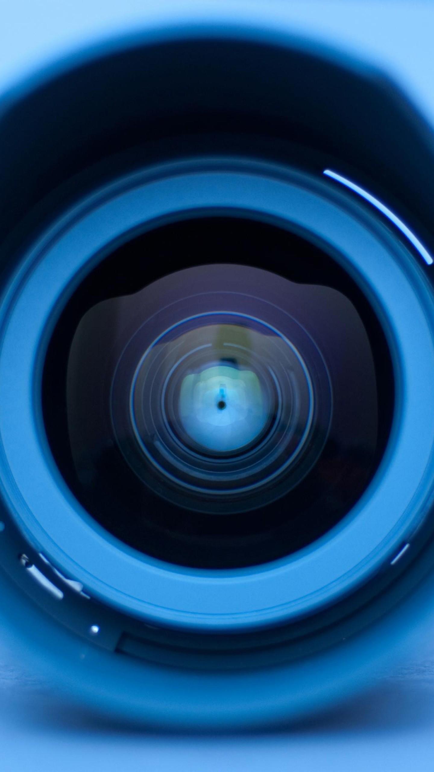 عکس زمینه فناوری زوم دوربین با لنز آبی پس زمینه