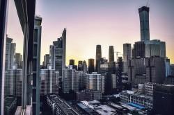 عکس زمینه ساختمان های بلند شهری