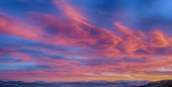 عکس زمینه رشته کوه برفی در غروب
