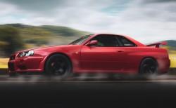 عکس زمینه نیسان GTR R34 سرخ در حال حرکت