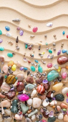 عکس زمینه سنگ های رنگی سالحل دریا
