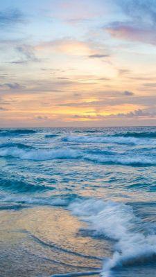 عکس زمینه امواج اقیانوس و آسمان زیبا