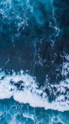 عکس زمینه امواج اقیانوس آبی تیره