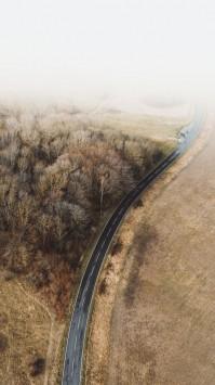عکس زمینه هوایی از جاده زیبا و سرد