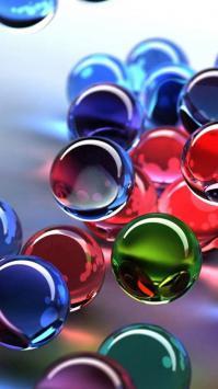 عکس زمینه تیله های رنگارنگ سه بعدی