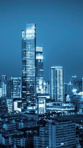 عکس زمینه شهر مدرن جهانی در شب و ساختمان های بلند