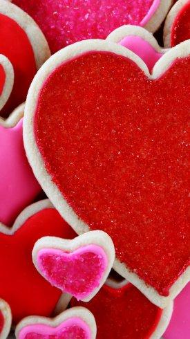 عکس زمینه قلب های بیسکویتی قرمز رنگ