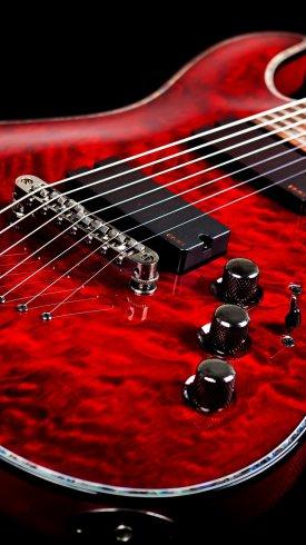عکس زمینه گیتار الکترونیکی گیتار قرمز با پس زمینه تاریک